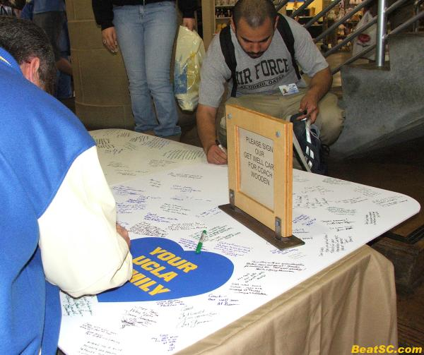 Giant get well card for Coach Wooden, who seemed to be controlling the Bruins' destiny from his hospital bed