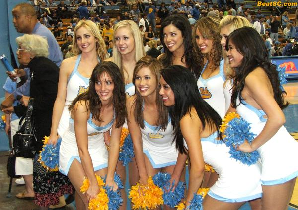 Here are ALL NINE members of the World Famous UCLA Dance Team… and yes, World Famous Jamaal Wilkes in the background