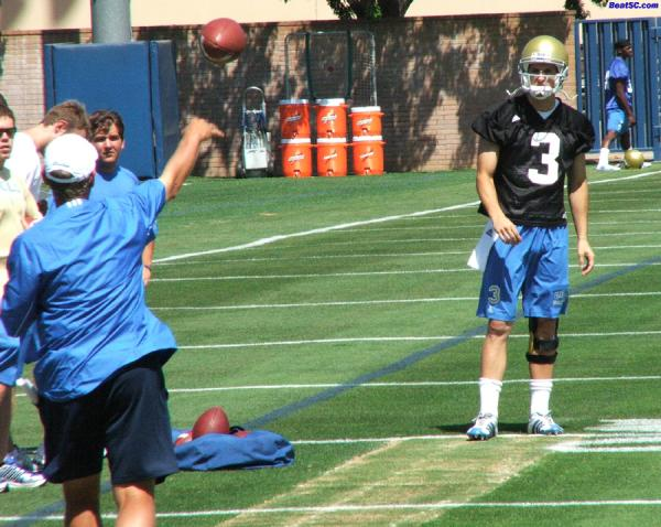 Neuheisel shows Craft how he won a Rose Bowl MVP Award.