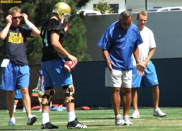 "Not only is Chow ""hands on,"" he's ""hands and feet on"" — Here he shows Kevin Prince the ""Brigham Young Heisman Two-Step."""