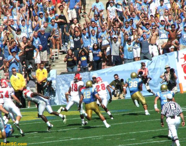 Bruin fans see Kahlil Bell curve right at them for a TD.
