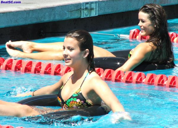 "The event ""headliner"" is the Innertube Relay with song girls and trojan football players (but who needs the players?)."