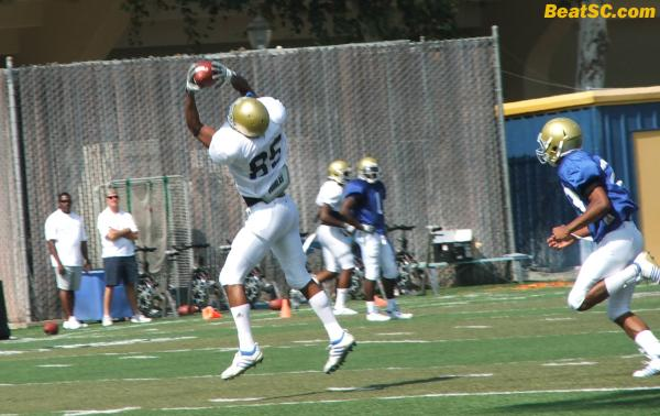 Jerry Johnson, wide open, looks it all the way into his hands.