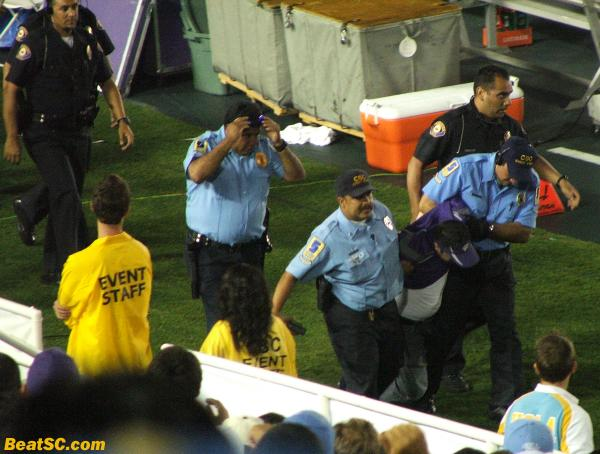 This Purple fan needed a little more Purple Kush, or some other way to mellow the hell out.  Instead, he was forcibly removed from the Rose Bowl. During the incident, a Cop punched another guy in the chest knocking him back.  It was the only hard hit of the night not made by Kyle Bosworth.