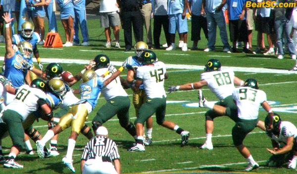 Here is the blocked Field Goal… One of the sole highlights of the game for UCLA (sadly).  The announcers all said Sheldon Price got it, but it looked more like someone on the interior line did.