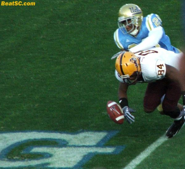 Glenn Love would have stopped this 2-pt conversion, if the guy didn't drop the ball first.  A successful try would have made it a one-possession game in the 4th quarter, and would have given the momentum to ASU.