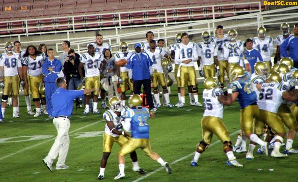 Neuheisel even called on old buddy and fellow former UCLA QB Wayne Cook to execute one Pass play.