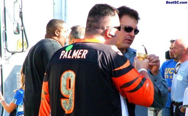 Now why is TIM WRIGHTMAN touching ice cream with a Carson Palmer fan?