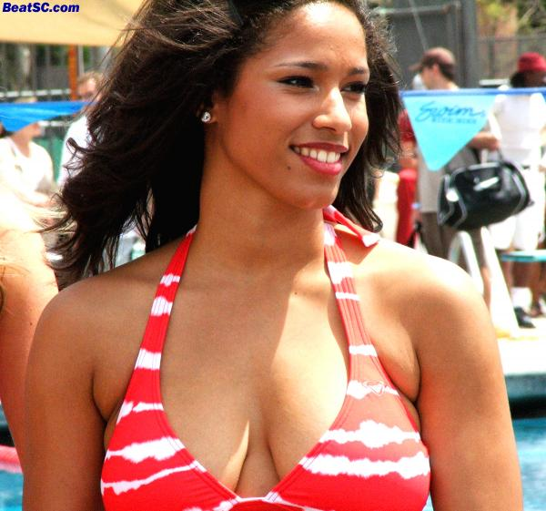 Another sweet, non-arrogant smile.  Maybe they are insecure because of the bikinis, but they have no reason to be.