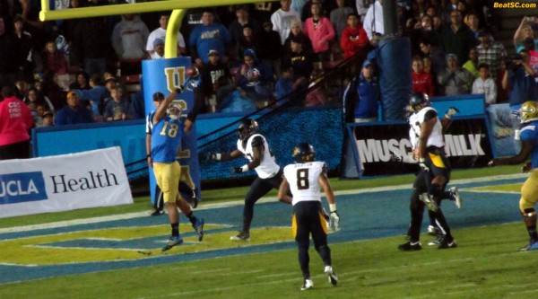 Hundley overthrows Thomas Duarte in the end zone, but earlier, the two did connect for 6 points