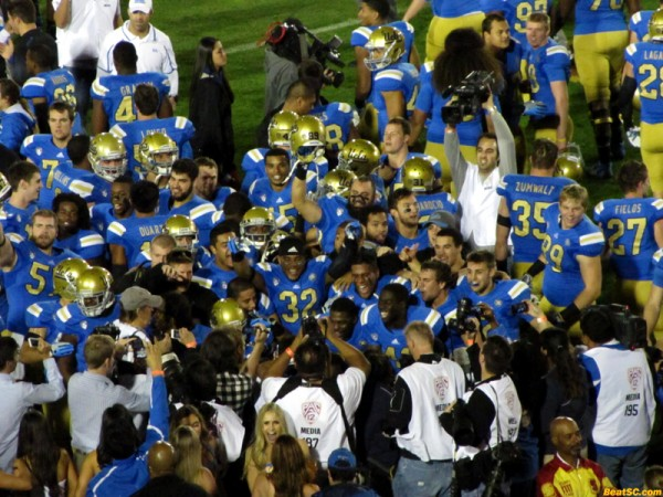 The players came over after the game to celebrate with the Bruin fans