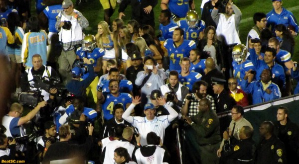 Coach Mora looks happy at UCLA, celebrating his second straight win over sc