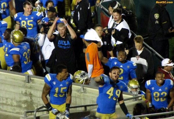 Devin Lucien, Luke Gane, and others sharing their victory joy with the UCLA fans